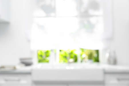 Blurred view of modern kitchen with window