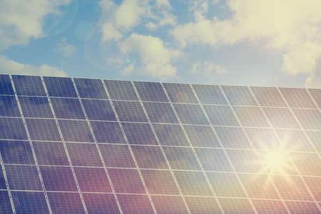 Solar panels against blue sky on sunny day. Alternative energy source