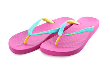 Pair of stylish pink flip flops isolated on white. Beach object