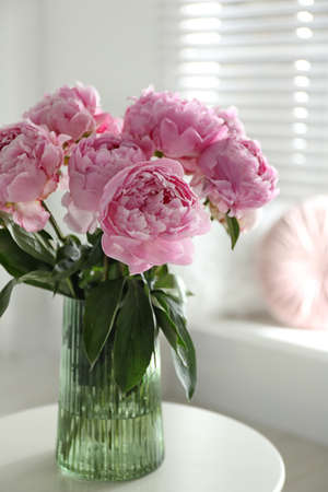 Bouquet of beautiful peonies on table indoors