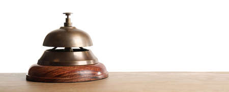 Hotel service bell on wooden table against white background
