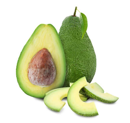 Cut and whole fresh avocados on white background