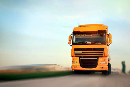 Logistics concept. Truck on country road, motion blur effect