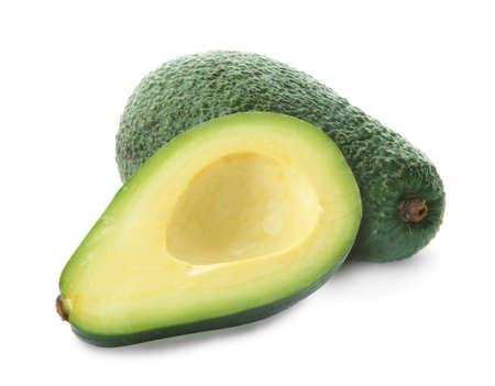 Cut and whole fresh avocados on white background Фото со стока