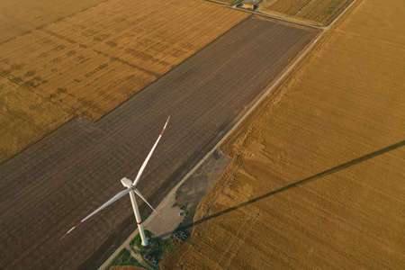 Aerial view on modern wind turbine. Alternative energy source 免版税图像