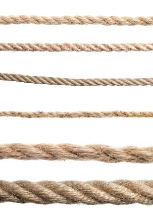 Set of hemp ropes on white background