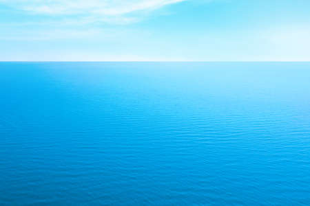 Beautiful ripply sea under blue sky with clouds