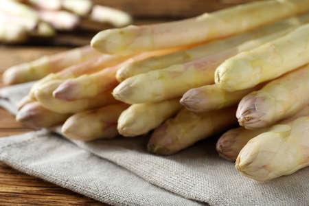 Fresh white asparagus on wooden table, closeup