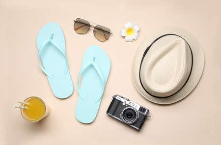 Beach accessories on beige background, flat lay