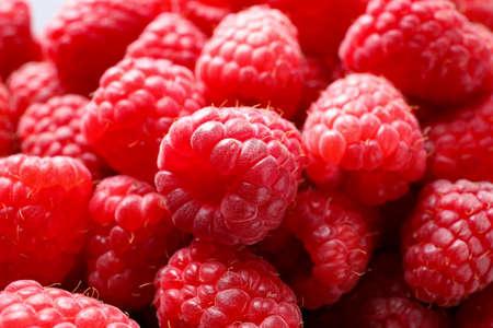 Fresh sweet ripe raspberries as background, closeup Foto de archivo