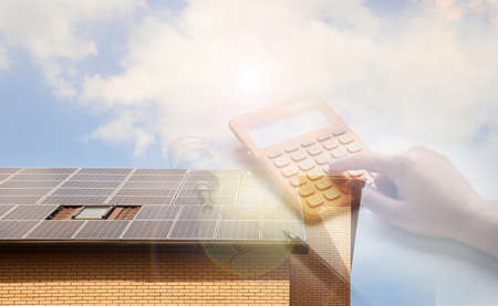 Double exposure of house with installed solar panels and woman using calculator. Renewable energy and money saving Standard-Bild