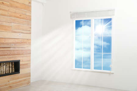 Beautiful view on blue sky with clouds through window in room Stockfoto