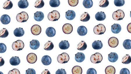 Cut and whole fresh blueberries on white background