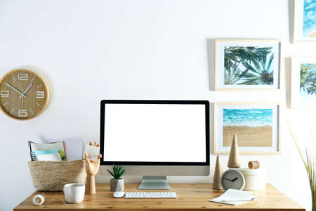 Home workplace with modern computer and desk in room. Mockup for design