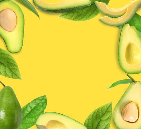 Frame of ripe avocados on yellow background. Space for text Stockfoto