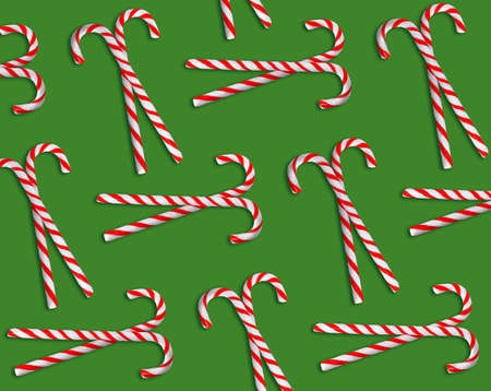 Pattern of Christmas candy canes on green background, top view