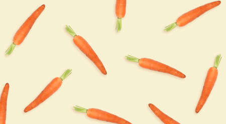 Whole carrots on beige background, banner. Pattern design Foto de archivo