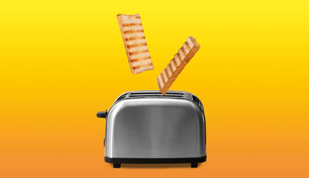 Slices of grilled wheat bread flying out of toaster on color background