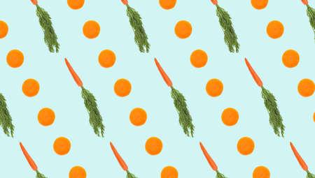 Carrots on pale light blue background, banner. Pattern design