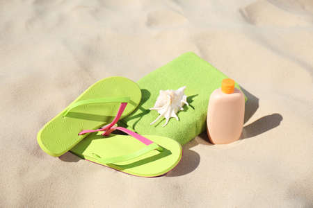 Stylish beach accessories for summer vacation on sand