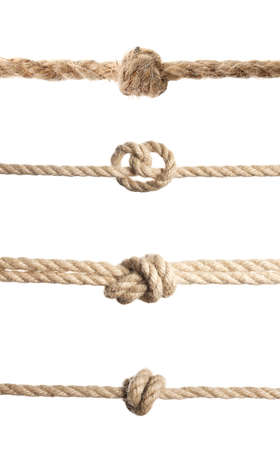 Set of hemp ropes with knots on white background