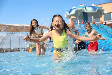 Happy family having fun at water park. Summer vacation Stock fotó