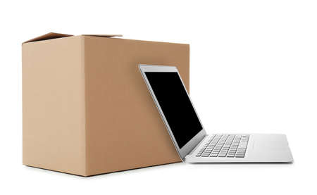 Online selling. Laptop and parcel on white background