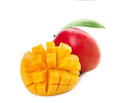 Whole and cut ripe mangoes isolated on white. Exotic fruit Foto de archivo