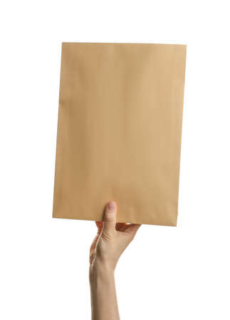 Woman holding kraft paper envelope on white background, closeup