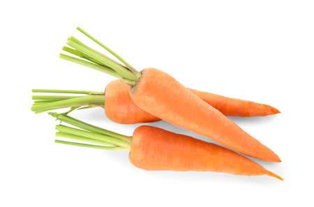 Pile of fresh ripe carrots isolated on white, top view
