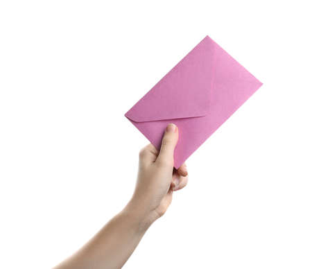 Woman holding pink paper envelope on white background, closeup