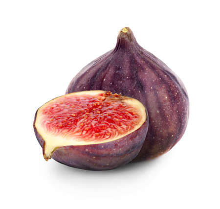 Cut and whole fresh figs on white background