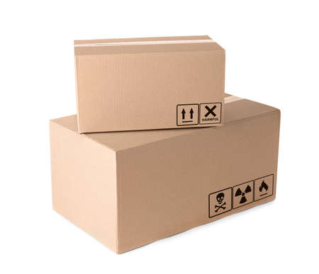 Cardboard parcels with different packaging symbols on white background