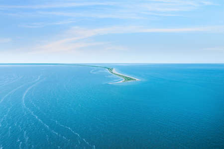 Beautiful seascape with spit under blue sky