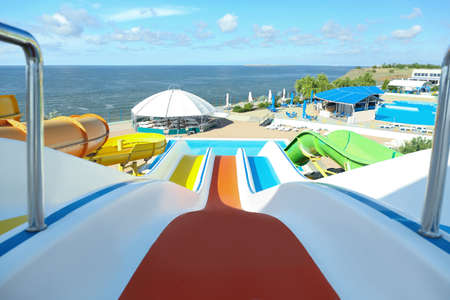 View from colorful slide in water park on sunny day Reklamní fotografie
