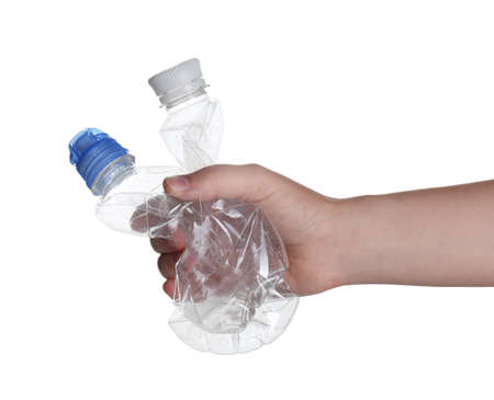 Woman holding crumpled bottles on white background, closeup. Plastic recycling