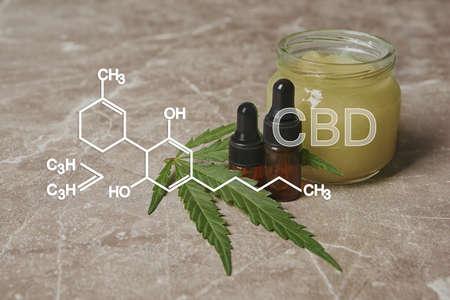 Composition with hemp oil on gray table. CBD formula