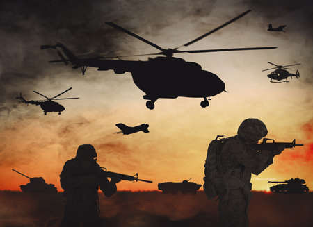 Troops on battlefield at sunset. Military service Stock Photo