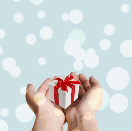 Boxing day, banner design. Woman with gift on light background, closeup Stock Photo