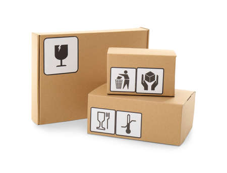Cardboard boxes with different packaging symbols on white background. Parcel delivery