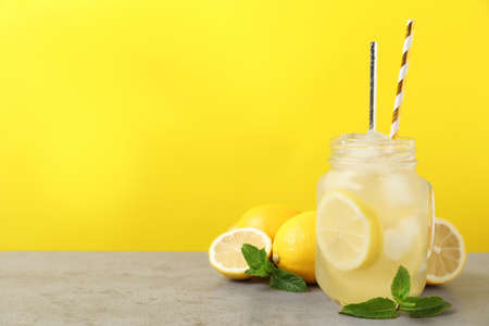 Natural freshly made lemonade with mint on light gray table. Summer refreshing drink