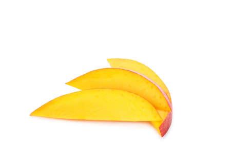 Slices of ripe mango isolated on white. Exotic fruit