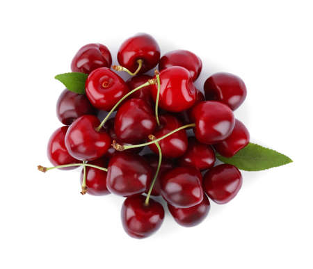 Tasty ripe red cherries with green leaves isolated on white, top view
