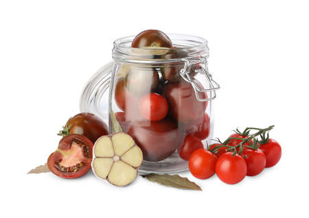 Pickling jar with fresh ripe cherry tomatoes and spices on white background