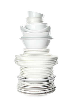 Stack of clean tableware isolated on white