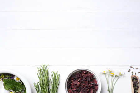 Flat lay composition with healing herbs on white wooden table. Space for text Banque d'images