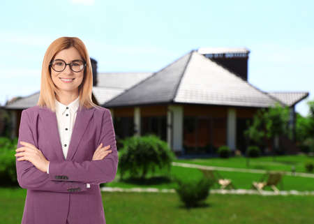 Real estate agent against modern house with garden. Space for text