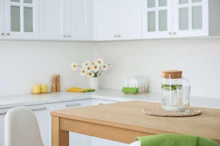 Stylish wooden table in beautiful kitchen interior Reklamní fotografie