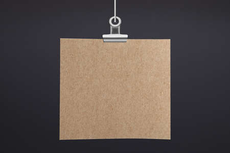 Blank poster hanging near dark gray wall. Space for design