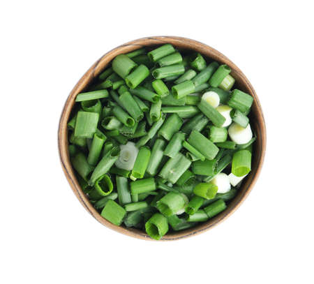 Cut green spring onion in wooden bowl isolated on white, top view